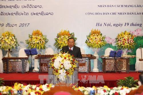 越南领导设宴欢迎老挝人革党中央总书记、国家主席本扬·沃拉吉 hinh anh 2