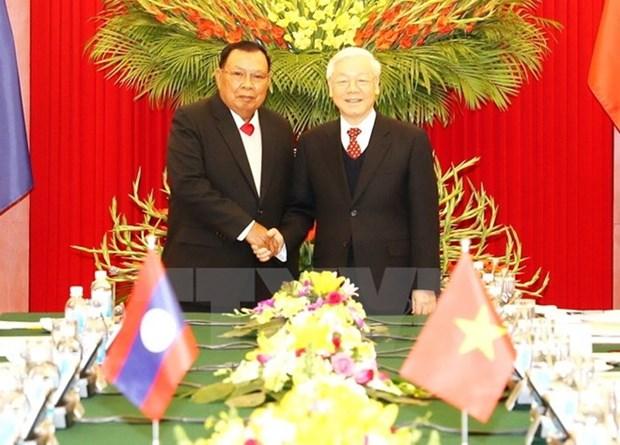 越老建交55周年:越老两国团结友谊不断得以巩固与发展 hinh anh 1