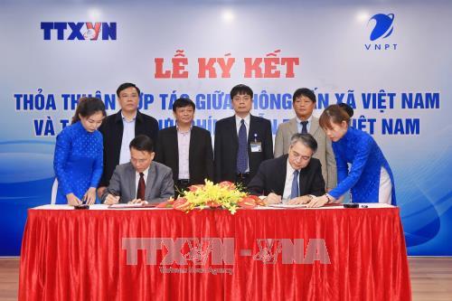 越通社与越南邮政通信集团签署合作协议 hinh anh 1
