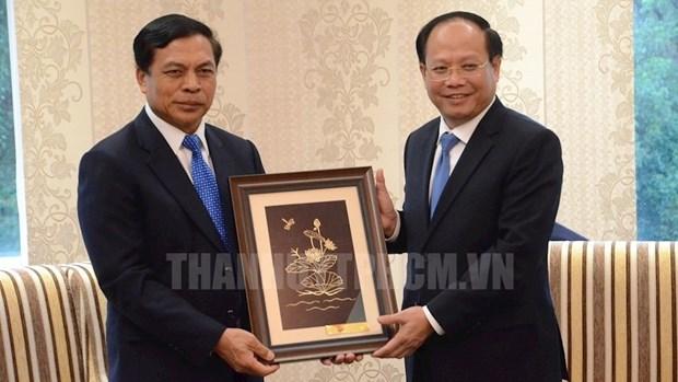 胡志明市领导会见老挝最高人民检察院检察长 hinh anh 1