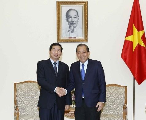 政府常务副总理张和平会见老挝最高人民法院院长坎潘·西提丹帕 hinh anh 1