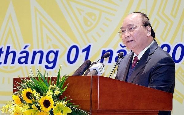 政府总理阮春福:银行信贷应继续发挥助推经济增长的作用 hinh anh 1