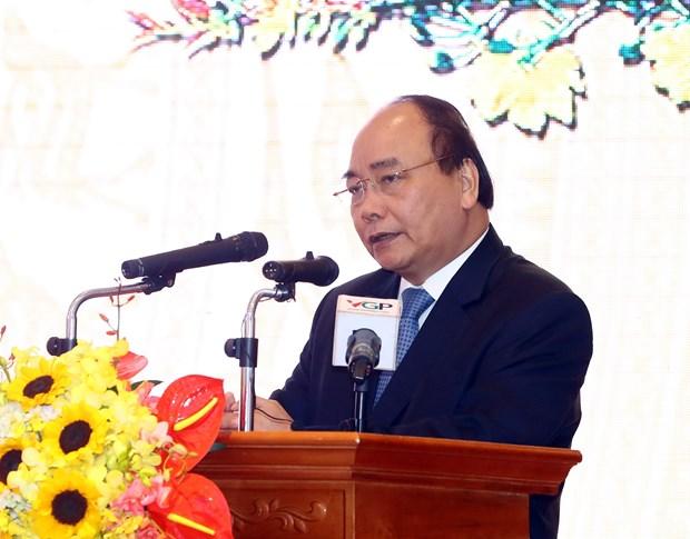 阮春福总理会见政府办公厅离退休干部代表 hinh anh 1