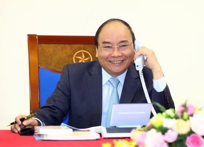 阮春福总理通电话祝贺教练朴恒绪以及越南U23足球队 hinh anh 1