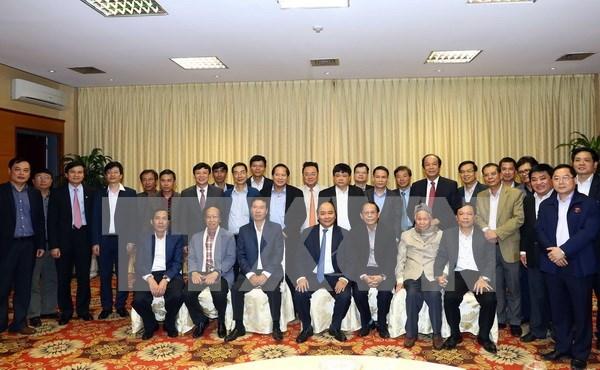 越南政府总理阮春福与国内新闻媒体机构领导举行见面会 hinh anh 1