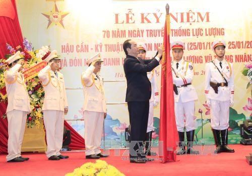 国家主席陈大光出席越南人民公安后勤技术力量成立70周年纪念典礼 hinh anh 1