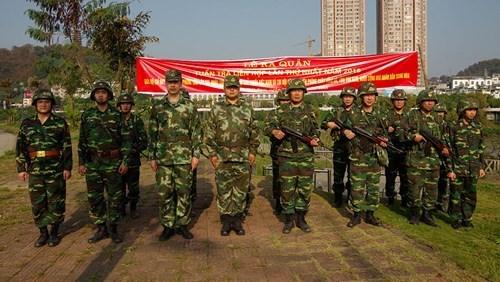 老街省边防部队与中国红河州公安边防支队开展2018年首次边境联合巡逻活动 hinh anh 2