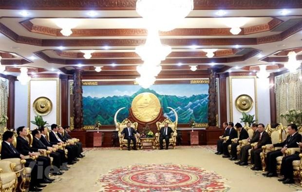 老挝领导高度评价越南公安部与老挝公安部之间的合作成果 hinh anh 1