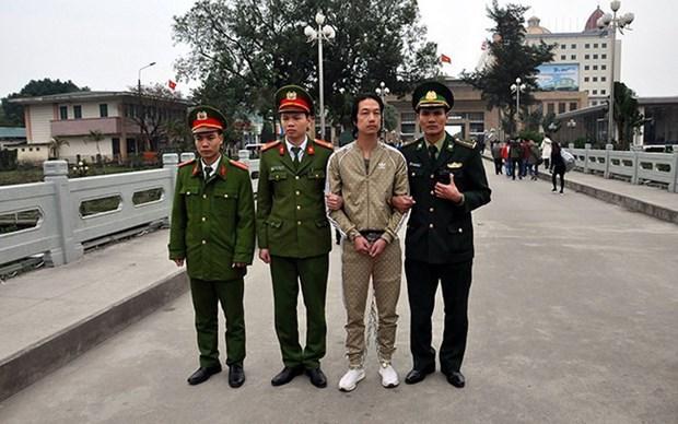 越南警方将通缉在逃犯移交中方 hinh anh 1