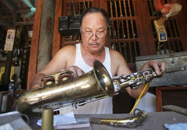 越南南定省海后县的西洋管乐器生产业 hinh anh 2