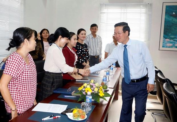 越南国家领导人赴各地拜年 hinh anh 2
