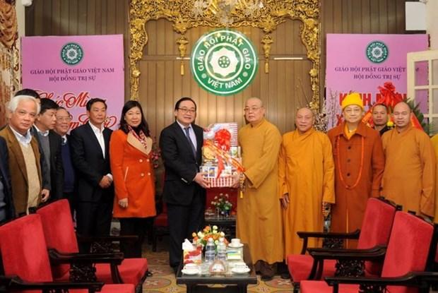河内市委书记黄忠海给越南佛教协会领导拜年 hinh anh 1