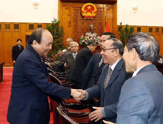 政府总理阮春福会见越南援柬专家联络委员会代表 hinh anh 2