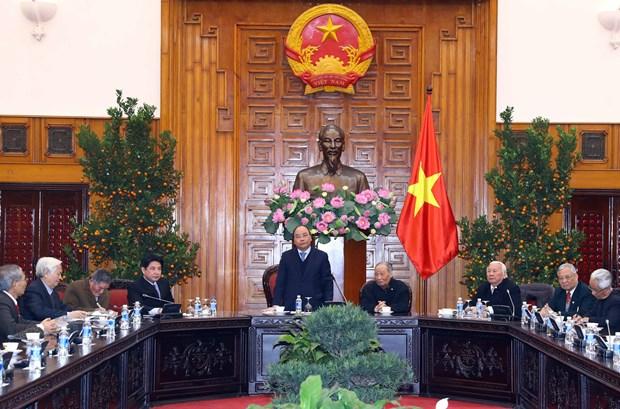 政府总理阮春福会见越南援柬专家联络委员会代表 hinh anh 1