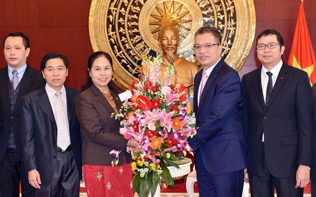 老挝驻中国大使前往越南驻中国大使馆庆祝越南传统节日春节 hinh anh 1
