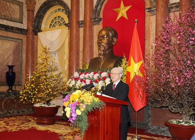 越共中央总书记阮富仲向党、国家领导、全国同胞和战士拜年 hinh anh 1