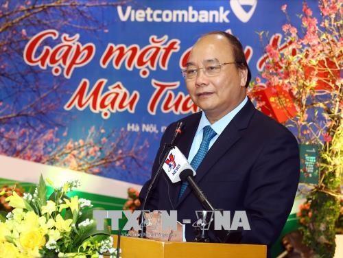 政府总理阮春福来到Vietinbank和Vietcombank两家银行拜年 hinh anh 2