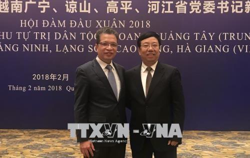 越南边境四省与中国广西党委书记举行新春会晤 hinh anh 1
