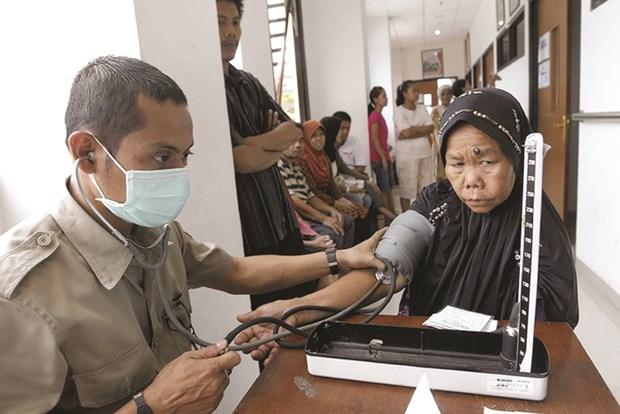 印尼向全民普及医疗卫生保险 hinh anh 1