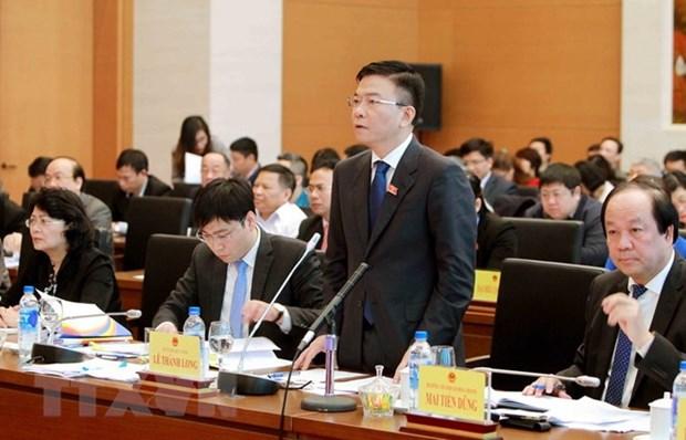 国会常委会第22次会议:司法部部长黎成龙接受质询 hinh anh 1