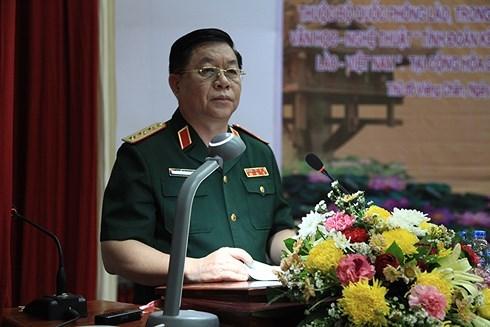 越南人民军总政治局副主任阮仲义上将拜会老挝人民军总政治局主任维莱•拉坎冯中将 hinh anh 1