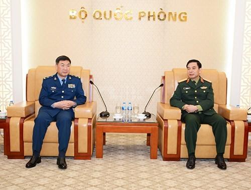 越南与中美两国加强防务合作 hinh anh 1