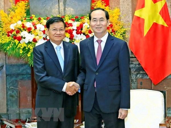 越南国家主席陈大光会见老挝总理通伦·西苏里 hinh anh 1