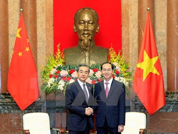越南国家主席陈大光会见中国外交部长王毅 hinh anh 1
