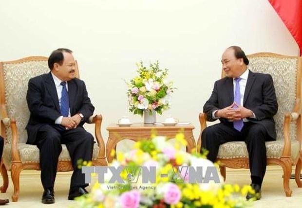 政府总理阮春福会见老挝能源与矿产部长坎马尼 hinh anh 1