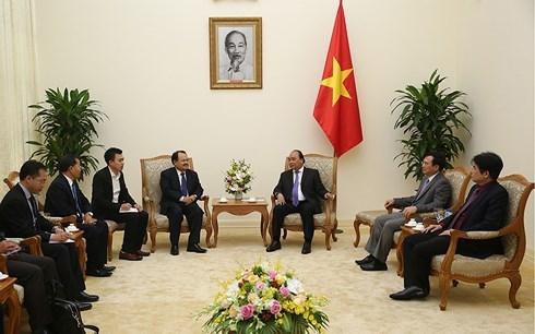 政府总理阮春福会见老挝能源与矿产部长坎马尼 hinh anh 2