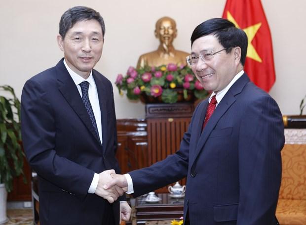 越南政府副总理兼外长范平明会见韩国驻越大使李赫 hinh anh 1