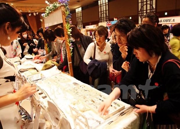 越南参加亚太妇女协会第42次慈善义卖活动 hinh anh 1