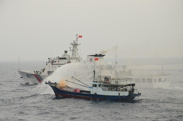 越中海警举行北部湾共同渔区海上搜救演练活动 hinh anh 1