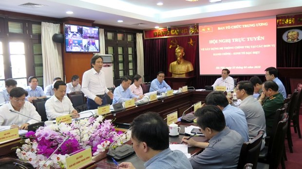 党和政治体系建设:在特别行政经济区建设政治体系 hinh anh 1