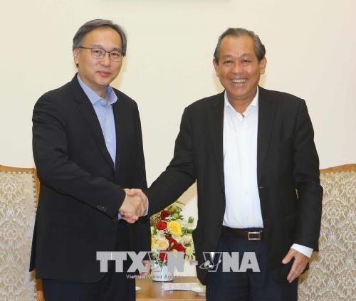 越南政府常务副总理张和平会见新加坡内政部常务副部长 hinh anh 1