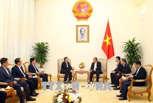 越南政府常务副总理张和平会见新加坡内政部常务副部长 hinh anh 2