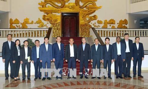 越南政府常务副总理张和平会见新加坡内政部常务副部长 hinh anh 3