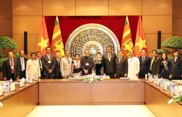 国会主席阮氏金银与斯里兰卡议会议长卡鲁举行会谈 hinh anh 3