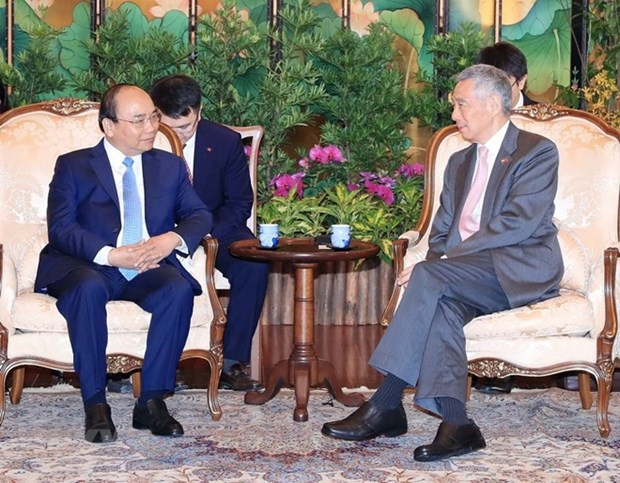 越南与新加坡发表联合声明 hinh anh 1