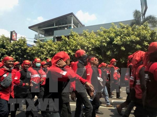 五·一国际劳动节:印尼劳工要求该国政府采取措施限制外籍劳工数量 hinh anh 2