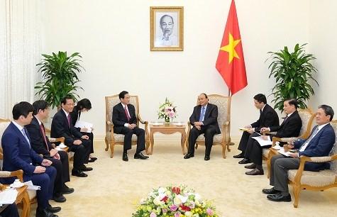 阮春福总理:越南希望日本为越南水产品与水果进军该国市场提供便利 hinh anh 1