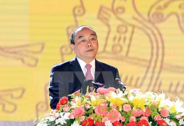 阮春福:拥有世界自然遗产、文化遗产、记忆遗产的越南正日益强大 hinh anh 2