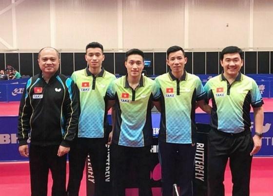 越南乒乓球队获得世乒赛团体赛第二层级的入场券 hinh anh 1