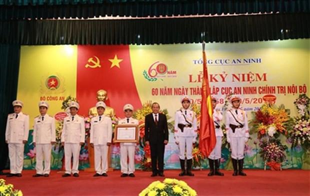 越南政府常务副总理张和平出席内部政治安全局成立60周年纪念大会 hinh anh 1
