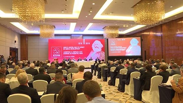 越南共产党代表团出席在俄罗斯举行的国际研讨会 hinh anh 1