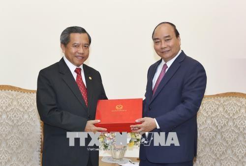 越南政府总理阮春福会见老挝科学技术部部长 hinh anh 1