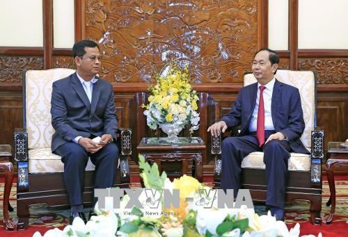 越南国家主席陈大光会见老挝公安部副部长 hinh anh 2