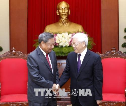 越共中央总书记阮富仲会见老挝人民革命党中央组织部代表团 hinh anh 1