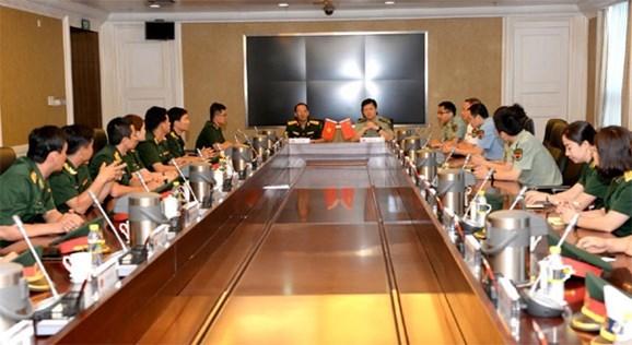 2018年越中青年军官交流活动在中国北京举行 hinh anh 1