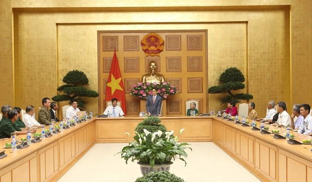 越南政府副总理武德儋会见得农省越南英雄母亲与革命有功者代表团 hinh anh 1